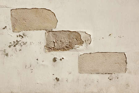 exfoliate: White Brick Wall Texture Or Background With Grey Damaged Cement Plaster Coating Stock Photo