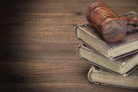 tomes: Wooden Judges Or Auctioneer Gavel And Old Law Books On The Rough Wooden Table In The Background. Law Concept. Top View Stock Photo