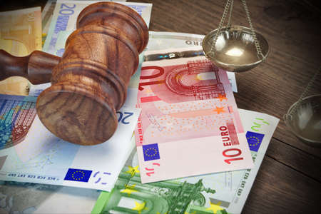 confiscation: Concept For Corruption, Bankruptcy Court, Bail, Crime, Bribing, Fraud.  Judges or Auctioneer Gavel And Bundle Of Euro Cash On The Rough Wooden Table. Top View Stock Photo