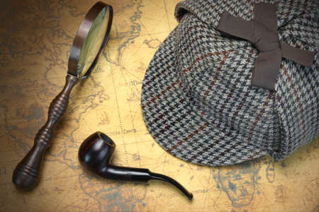 holmes: Deerstalker Sherlock Holmes Hat, Vintage Magnifier And Smoking Pipe On The Old World Map Background. Overhead View.  Investigation Concept. Stock Photo