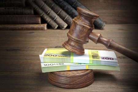 bail: Concept For Corruption, Bankruptcy, Bail, Crime, Bribing, Fraud, Auction. Judges or Auctioneer Gavel, Soundboard, Bundle Of Euro Cash And Old Law Book  Library On Stock Photo
