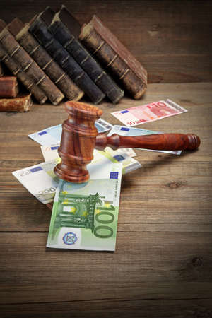 bail: Concept For Corruption, Bankruptcy, Bail, Crime, Bribing, Fraud, Auction  Judges or Auctioneer Gavel, Soundboard, Bundle Of Euro Cash And Old Law Book  Library On The Rough Wooden Table Background.