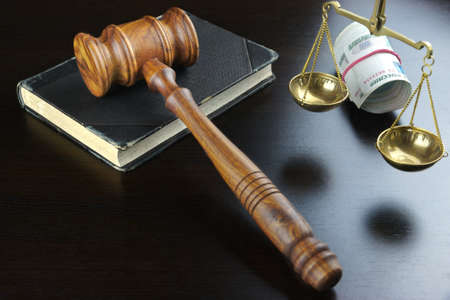 bail: Concept For Corruption, Bankruptcy, Bail, Crime, Bribing, Fraud. Judges Gavel, Scale Of Justice, Old Law Book And Russian Cash On The Rough Black Wooden Textured Table Background.