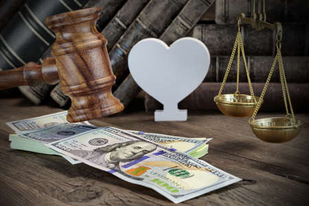 bail: Concept For Corruption, Bankruptcy Court, Bail, Crime, Bribing, Fraud, Judges Gavel, Soundboard And Bundle Of Dollar Cash On The Rough Wooden Textured Table Background. Stock Photo