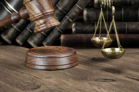 advocates: Closeup Of Jydjes Gavel, Legal Code, Scales Of Justice On The Rough Wooden Background. Law Concept Stock Photo