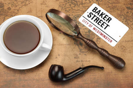 sherlock: Sign BAKER STREET, Smoking Pipe, Vintage Magnifier, Full Teacup On The Old World  Map. London Travel Concept. Overhead View Stock Photo