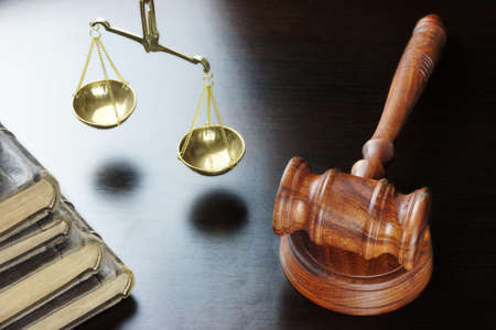 fair trial: Judges Gavel, Old Law Book And Scale Of Justice On The Black Table Background  In Back Light. Overhead View. Law Concept Stock Photo