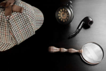 sleuth: Sherlock Holmes Deerstalker Hat, Vintage Clock, Retro Magnifier And Smoking Pipe On The Black Table Background. Overhead View.  Investigation Concept.
