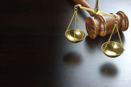 Judges Gavel And Scale Of Justice On The Black Table Background  In Back Light. Overhead View. Law Concept Stock Photo