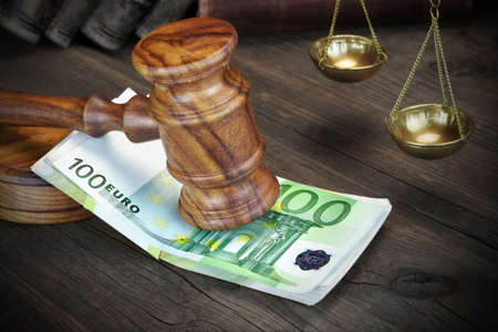 Concept For Corruption, Bankruptcy Court, Bail, Crime, Bribing, Fraud.  Judges or Auctioneer Gavel And Bundle Of Euro Cash On The Rough Wooden Table. Top View Stock Photo