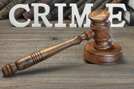 crime prevention: Judges Gavel, Sign CRIME And Old Law Book On Rough Wooden Table. Crime Prevention Concept Stock Photo