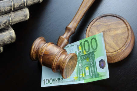 fraud: Concept For Corruption, Bankruptcy, Bail, Crime, Bribing, Fraud, Auction Bidding. Judges or Auctioneer Gavel, Soundboard And Euro Cash On The Rough Black Wooden Textured Table Background. Stock Photo