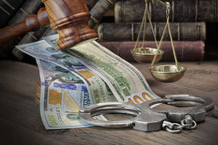 bribing: Concept For Corruption, Bankruptcy Court, Bail, Crime, Bribing, Fraud, Judges Gavel, Soundboard And Bundle Of Dollar Cash On The Rough Wooden Textured Table Background. Stock Photo