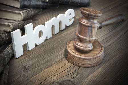 bidding: Sign Home, Judges Or Auctioneer Gavel And Old Law Book On The Wood Table. Concept For Trial, Bankruptcy, Tax, Mortgage,  Auction Bidding, Foreclosure Or Inherit Real Estate Stock Photo