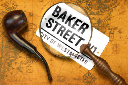 sherlock: Sign BAKER STREET, Smoking Pipe, Magnifier On The OLD Map. London Travel Concept. Overhead View Stock Photo