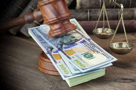 soundboard: Concept For Corruption, Bankruptcy Court, Bail, Crime, Bribing, Fraud, Judges Gavel, Soundboard And Bundle Of Dollar Cash On The Rough Wooden Textured Table Background. Stock Photo