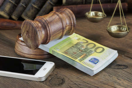 fraud: Concept For Corruption, Bankruptcy Court, Bail, Crime, Bribing, Fraud. Judges Gavel,  Bundle Of Euro Cash  And Mobile Phone On The Wooden Textured Table Background. Front View Stock Photo