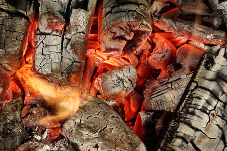 briquettes: Hot Charcoal Briquettes Glow In BBQ Grill Pit Background Texture, Overhead View Stock Photo