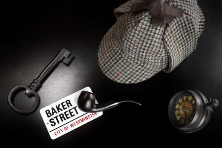 inference: Baker Street Sign And Sherlock Holmes Items On The Black Wood Tablet Background