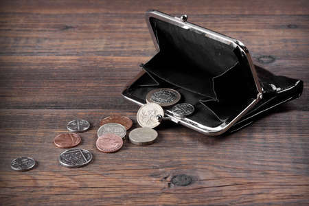 empty wallet: Open Male Black Leather Wallet With British Different Coins On The Old Rough Brown Wooden Textured Background With Copy Space, Top View Stock Photo