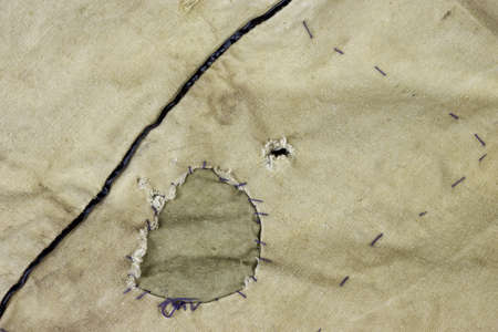 clout: Weathered Military Army  Khaki Camouflage Fabric With Patch, Background Texture, Close Up, Top View