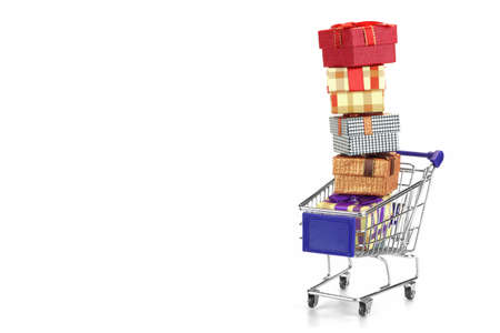 box big: Shopping Cart With Stack Of Many Gift Boxes Isolated On White Background, Horizontal Image With Copy Space Stock Photo