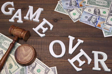 confiscation: Sign Game Over, American Dollars Cash  Judges Gavel On The Wood Rough Table Background. Concept For  Bankruptcy, Gambling, Fraud, Bribe, Bail, Illegal Income, Tax Stock Photo