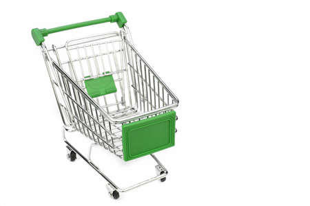 empty shopping cart: New Empty Shopping Cart  With Green Advertising Display Isolated On White Background , Close Up, High Angle View