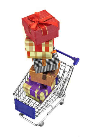 moll: Shopping Cart With Stack Of Many Gift Boxes Isolated On White Background, Vertical Image