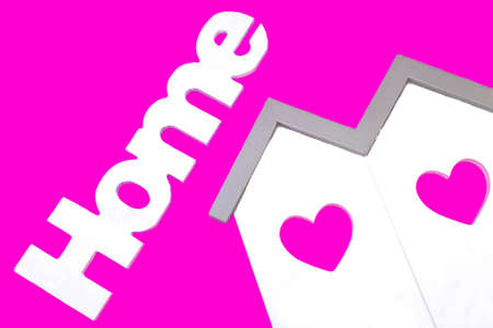 roof house: White Small House Wooden Model  With Two Windows In The Shape Of A Heart And Sign Home Isolated On The Pink Background, Close Up