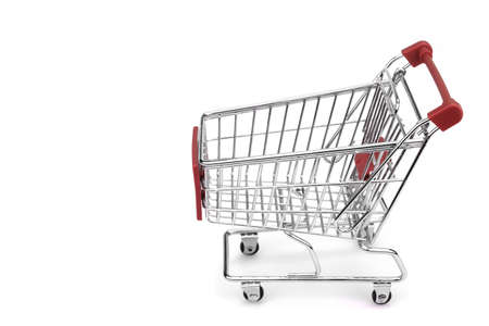 empty shopping cart: New Empty Shopping Cart  With Red Advertising Display Isolated On White Background , Close Up, Side View