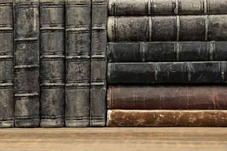 Old Shabby Books With Black Leather Cover On The Bookshelf Horizontal Background Texture