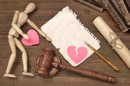 paper heart: Divorce Concept In The Court. Gavel, Law Book, Judges Gavel, Empty White Page, Broken Paper Heart On Wood Background