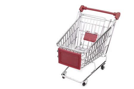 empty shopping cart: New Empty Shopping Cart  With Red Advertising Display Isolated On White Background , Close Up, High Angle View