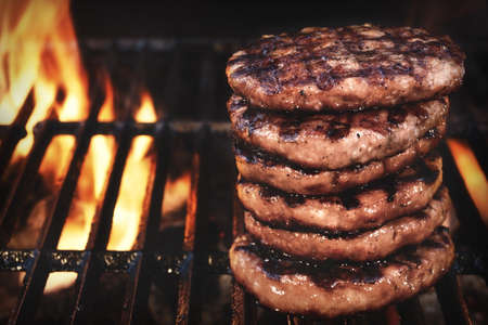 sizzle: BBQ Grilled Burgers Patties On The Hot Flaming Charcoal Grill, Top View. Cookout Food, Good Snack For Outdoor Party Or Picnic