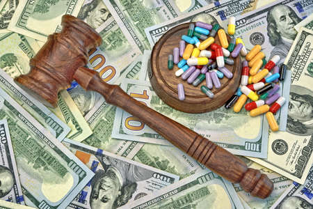 Wood Judges Gavel And Scattered Colorful Drugs On The Dollar Cash Background, Overhead View Reklamní fotografie