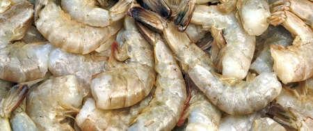 king size: Pile of Green Raw King Size Shrimps (Penaeidae Shrimps)Or Prawns Isolated On White Background Stock Photo
