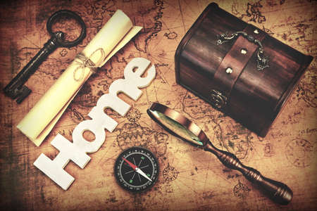 paper roll: Travel Concept, Still Life Objects Key, Paper Roll, Home Sign, Magnifier, Compass And Key On Vintage Old Map Background With Photo Filter Stock Photo