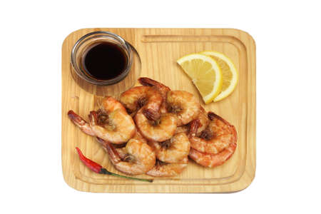 king size: Grilled Red King Size Shrimps Or Prawns With Sauce, Chili Pepper and Lemon, Served On Wood Board  Isolated On White Background, Close Up, Top View
