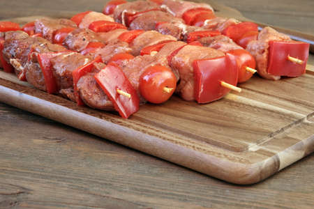 kebob: Uncooked Marinated And Rubbed Shish Kebabs From Pork Tenderloin On Skewers Ready For Grilling In BBQ