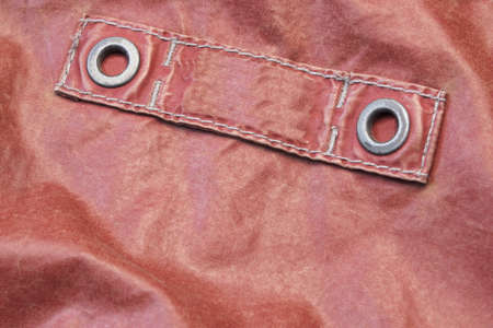 sewn up: Red Modern Leather Jacket Fragment With Empty Label, Close Up, Background With Copy Space Stock Photo