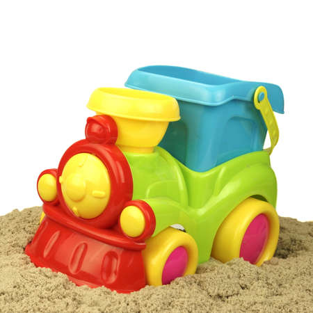 truckload: Close-up Of Toy Train With Kinetic Sand Heap Isolated On White Background.