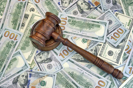 auctioning: Judges Or Auctioneer Gavel On The Dollar Cash Background, Top View, Close-Up. Stock Photo