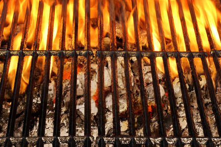 briquettes: Overhead View Of Empty BBQ Hot Fire Grill And Burning Charcoal Briquettes With Bright Flames. Outdoor Scene. Concept for Summer Party Or Picnic Or Cookout. Isolated Black Background. Close Up