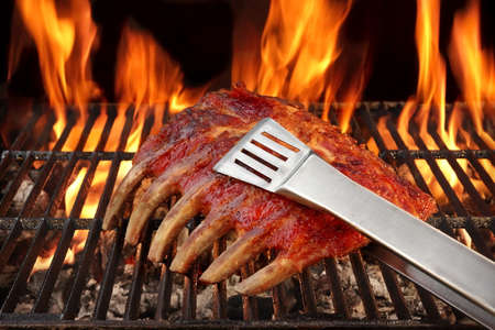 ribcage: Roasted Country Style Baby Back Or Spare Ribs On The Hot Flaming BBQ Grill, Close-up
