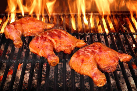sizzle: Three Crispy And Tasty BBQ Chicken  Quarters Roasted On The Hot Charcoal Flaming Grill, Closeup, Top View Stock Photo