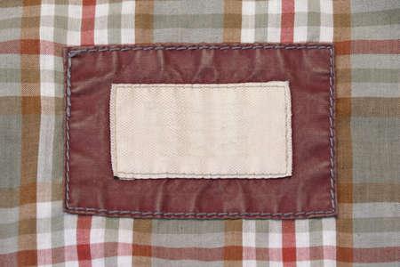 Antecedentes lado interior de la chaqueta de cuero con la etiqueta de la tela vacía, vista superior Foto de archivo - 55306088