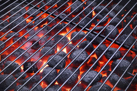 briquettes: BBQ Grill And Glowing Hot Charcoal Briquettes In The Background, Close-Up, Top View. Concept For Outdoor Barbecue Party Or Picnic Or Cookout