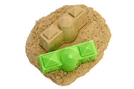 kinetic: Sand Castle Made From Kinetic Sand (Magic Sand) With Shovel And Mold Isolated On White Background, Front View, Close Up