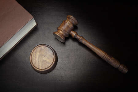 legislator: Top View Of Judges Gavel, Red Law Book On The Black Wood Background